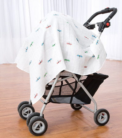 pram draped with protective muslin wrap